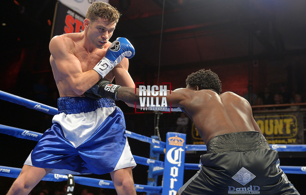 Chris Algieri(blue/white shorts) and Emmanuel Taylor(black shorts) face each other for the main event on ESPN Friday Night Fights held at The Paramount Theater in Huntington, New York on February 14, 2014.