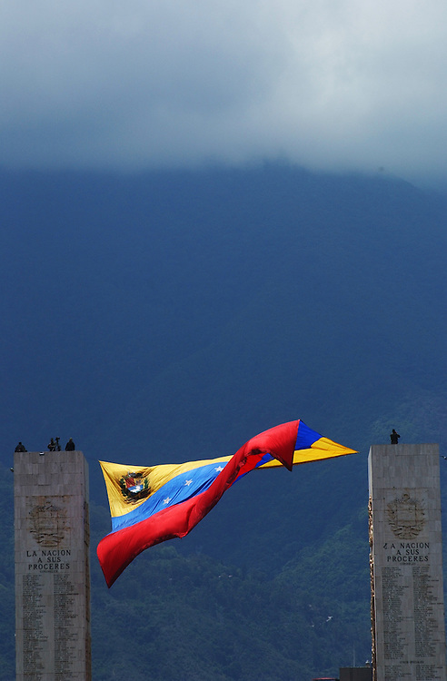 A flag waves at the edge of the Fuerte Tiuna military base where there was a parade celebrating the 192nd Venezuelan Indepenedence Day.