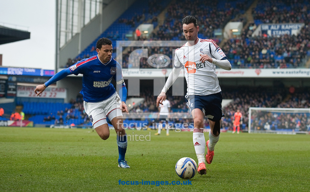 Picture by Will Oliver/Focus Images Ltd 075966707272.16/03/2013.Carlos Edwards of Ipswich Town and Chris Eagles of Bolton Wanderers at the npower Championship match at Portman Road, Ipswich.