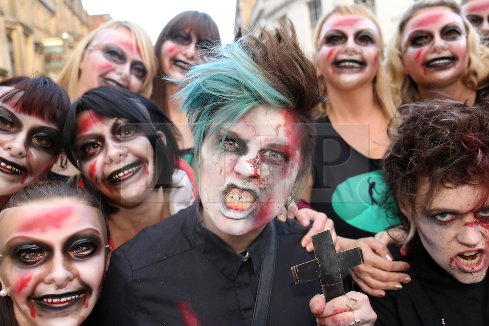 © Licensed to London News Pictures. 25/10/2014. Glastonbury, UK Participant in the Zombie walk in Glastonbury in Somerset today 26th October 2014. the walk is raising funds for Martha Care, a charity set up by parents for parents and families when they find themselves in hospital with a very ill or injured childPhoto credit : Jason Bryant/LNP