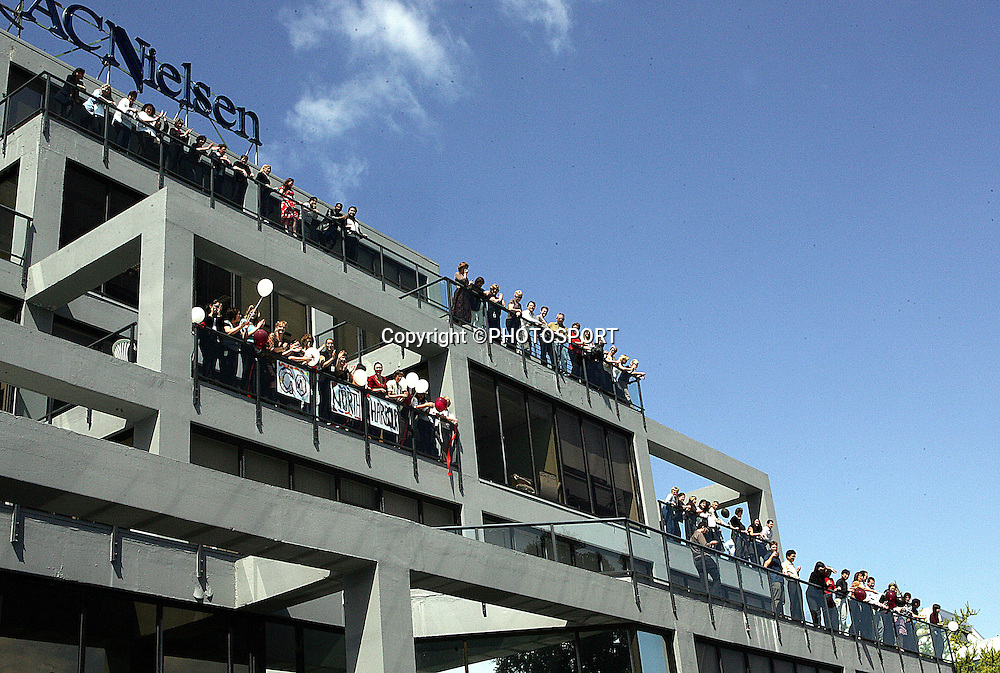 Harbour fans watch the parade from the balcony of the AC Nielsen building during the street parade for the North Habour Air NZ Cup team who won the Ranfurly Shield last weekend, at Takapuna, Auckland, on Thursday 28 September 2006. Photo: Tim Hales/PHOTOSPORT<br /><br /><br />280906