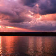 """""""Chasing Dreams""""<br /> <br /> Amazing deep burgundy and gold tones with dramatic skies at sunset on Lake Superior!"""