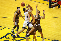 Dec 30, 2018; Morgantown, WV, USA; West Virginia Mountaineers forward Esa Ahmad (23) is fouled while driving down the lane during the first half against the Lehigh Mountain Hawks at WVU Coliseum. Mandatory Credit: Ben Queen-USA TODAY Sports