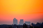 UNITED KINGDOM, London: 27 April 2017 A yellow sky is cast over the towers of Canary Wharf as the sun begins to rise on a cold day in London this morning. Rick Findler / Story Picture Agency