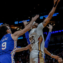 Dec 10, 2017; New Orleans, LA, USA; \New Orleans Pelicans forward Anthony Davis (23) shoots over Philadelphia 76ers forward Dario Saric (9) during the second quarter of a game at the Smoothie King Center. Mandatory Credit: Derick E. Hingle-USA TODAY Sports