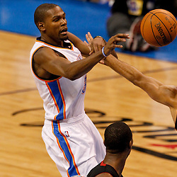 Jun 14, 2012; Oklahoma City, OK, USA; Oklahoma City Thunder small forward Kevin Durant (35) passes as Miami Heat small forward Shane Battier (31) defends during the third quarter of game two in the 2012 NBA Finals at Chesapeake Energy Arena. Mandatory Credit: Derick E. Hingle-US PRESSWIRE