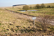 Chalk landscape scenery near Chitterne, Salisbury Plain, Wiltshire, England, UK sign no access for civilian vehicles