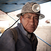 Mine worker pose for a picture outside the mine located in Oruru, Bolivia