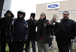 Workers of Ford Genk and its suppliers protest at the entrance of the Ford Genk assembly factory as other workers walk in to work again, in Genk of Belgium, Jan. 9, 2013, the first day to resume the production in 2013. A thin majority of workers voted to re-start to work for 40 more days in 2013 in an agreement between the direction and unions earlier in the week, but some others decided to block all access to the plant in protest. Ford Europe announced on October 24, 2012 to close its Genk plant at the end of 2014, threatening 4,300 jobs as slumping demand across Europe leaves companies with too much capacity, Brussels, Belgium, January 9, 2013. Photo by Imago / i-Images...UK ONLY