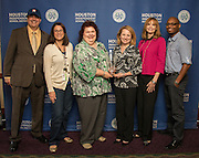 Houston Food Bank team members pose with a Hall of Fame trophy following the Houston ISD Partnership Appreciation breakfast at Kingdom Builders, October 25, 2013.