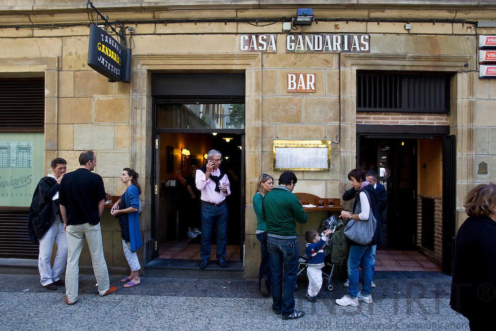 SAN SEBASTIAN - SPAIN - 23 JULY 2010 -- People standing outside the Tapas restaurant Casa Gandarias enjoying their tapas and drinks. PHOTO: ERIK LUNTANG / INSPIRIT Photo.