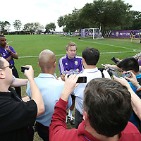Lions head coach Adrien Heath speaks to the international media after the first day of MLS soccer team practice for the Orlando City Soccer Club at Sylvan Lake Park on Friday, January 23, 2015 in Sanford,Florida. (AP Photo/Alex Menendez)
