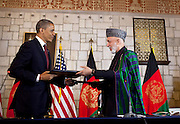 01.MAY.2012. KABUL<br /> <br /> PRESIDENT BARACK OBAMA AND AFGHAN PRESIDENT HAMID KARZAI EXCHANGE DOCUMENTS AFTER SIGNING THE STRATEGIC PARTNERSHIP AGREEMENT SIGNING CEREMONY AT THE PRESIDENTIAL PALACE IN KABUL, AFGHANISTAN, MAY 1, 2012.  <br /> <br /> BYLINE: EDBIMAGEARCHIVE.CO.UK<br /> <br /> *THIS IMAGE IS STRICTLY FOR UK NEWSPAPERS AND MAGAZINES ONLY*<br /> *FOR WORLD WIDE SALES AND WEB USE PLEASE CONTACT EDBIMAGEARCHIVE - 0208 954 5968*