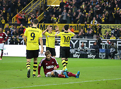 "01.03.2014, Signal Iduna Park, Dortmund, GER, 1. FBL, Borussia Dortmund vs 1. FC Nuernberg, 23. Runde, im Bild vl: Robert Lewandowski (Borussia Dortmund #9), Jonas Hofmann (Borussia Dortmund #7) iund Henrikh ""Micki"" Mkhihtaryan (Borussia Dortmund #10) beim Torjubel nach dem Treffer zum 3:0 mit Marvin Plattenhardt (1 FC Nuernberg #21) enttaeuscht, Emotion, Freude, Glueck, Positiv // during the German Bundesliga 23th round match between Borussia Dortmund and 1. FC Nuernberg at the Signal Iduna Park in Dortmund, Germany on 2014/03/01. EXPA Pictures © 2014, PhotoCredit: EXPA/ Eibner-Pressefoto/ Schueler<br /> <br /> *****ATTENTION - OUT of GER*****"