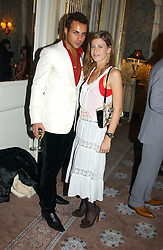 MARCUS KETTY and FRANCESCA VERSACE at a dinner hosted by Krug champagne at Claridge's, Brooke Street, London on 14th February 2006.<br /><br />NON EXCLUSIVE - WORLD RIGHTS