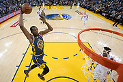 January 31, 2019; Oakland, CA, USA; Golden State Warriors forward Kevin Durant (35) dunks the basketball against the Philadelphia 76ers during the first half at Oracle Arena.