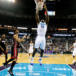 November 5, 2010; New Orleans, LA, USA; New Orleans Hornets center Emeka Okafor (50) dunks against the Miami Heat during the first half at the New Orleans Arena. Mandatory Credit: Derick E. Hingle