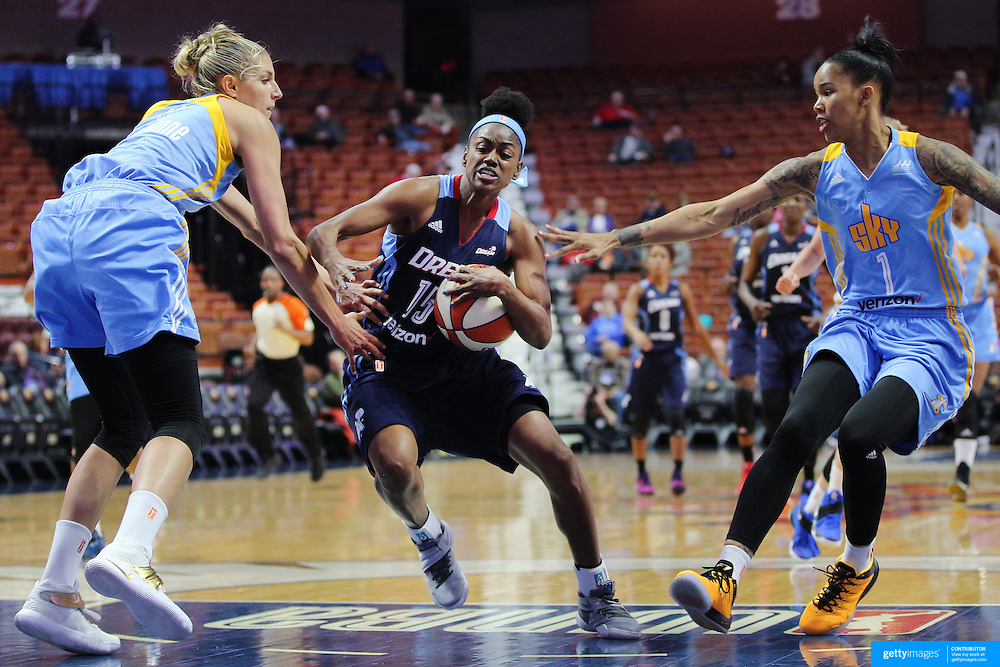 UNCASVILLE, CONNECTICUT- MAY 05: Tiffany Hayes #15 of the Atlanta Dream drives between Elena Delle Donne #11' (left), and Tamera Young #1 of the Chicago Sky during the Atlanta Dream Vs Chicago Sky preseason WNBA game at Mohegan Sun Arena on May 05, 2016 in Uncasville. (Photo by Tim Clayton/Corbis via Getty Images)