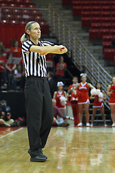 07 December 2012:  Referee Lisa Mattingly calls traveling during an NCAA women's basketball game between the Northwestern Wildcats and the Illinois Sate Redbirds at Redbird Arena in Normal IL