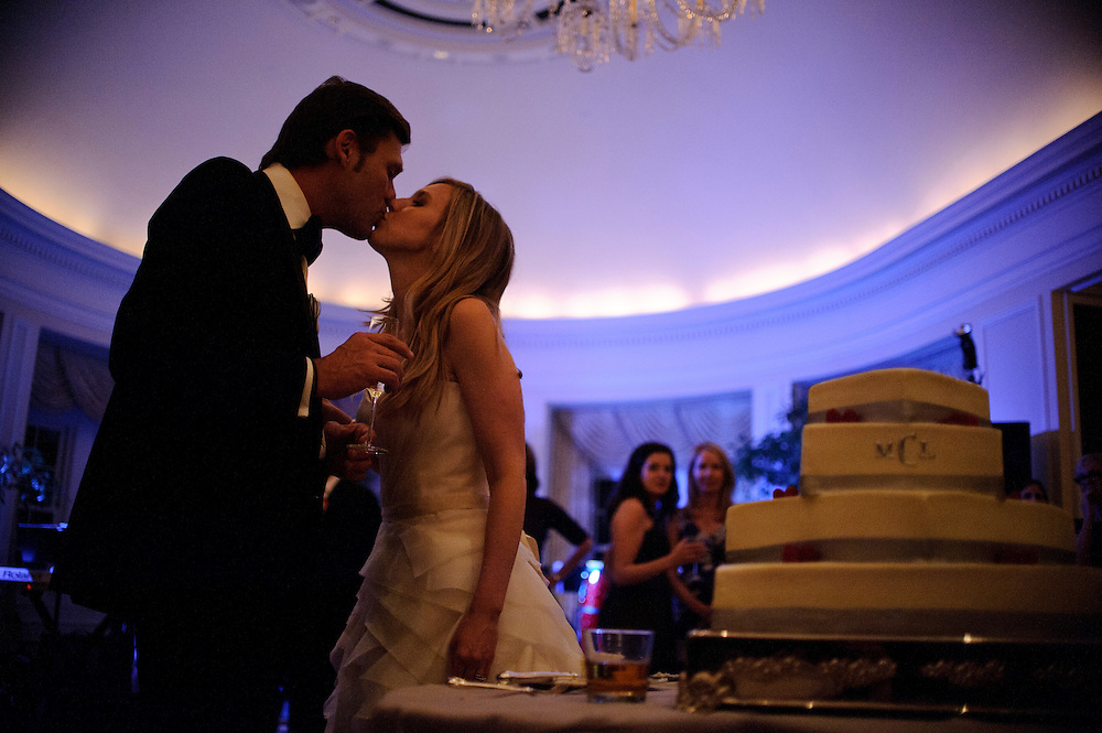 photo by Matt Roth.Saturday, April 14, 2012.Assignment ID: 30124225A..Lee Cowan and Molly Spencer Palmer kiss after cutting their cake at their wedding reception at the Chevy Chase Club in Washington D.C. Saturday, April 14, 2012...Molly Palmer, 29, and Lee Cowan, 46, were colleagues at NBC News, but it wasn't until The Balloon Boy story coverage in 2009 that their romance sparked.