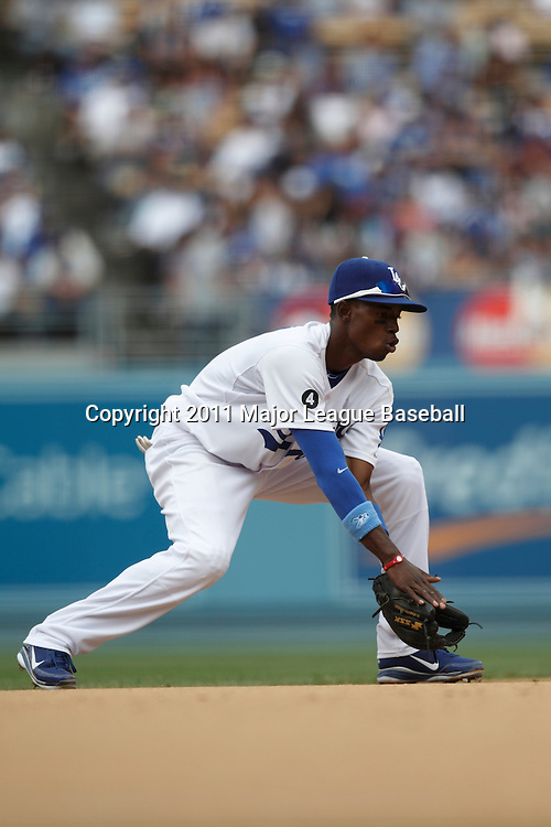 LOS ANGELES - JUNE 19:  Shortstop Dee Gordon #9 of the Los Angeles Dodgers catches a ground ball and throws to first base for a force out during the game against the Houston Astros at Dodger Stadium on Sunday, June 19, 2011 in Los Angeles, California.  The Dodgers defeated the Astros 1-0.  (Photo by Paul Spinelli/MLB Photos via Getty Images) *** Local Caption *** Dee Gordon