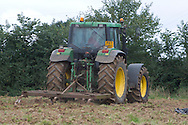 Tractor and pan buster in field