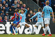 Crystal Palace forward Wilfried Zaha (11) and Manchester City midfielder Leroy Sane (19) await a high ball during the Premier League match between Crystal Palace and Manchester City at Selhurst Park, London, England on 14 April 2019.