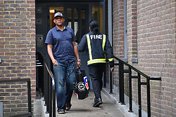 © Licensed to London News Pictures. 24/06/2017. London, UK. Residents continue to be evacuated from the Taplow block of the Chalcots Estate in Camden after it failed a fire inspection because of combustable cladding. More than 700 flats in tower blocks on an estate in the Swiss Cottage area of north-west London are being evacuated because of fire safety concerns. Photo credit: Ben Cawthra/LNP