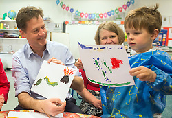 © Licensed to London News Pictures. 01/05/2014. Surbiton, UK. Nick Clegg holds up his painting of a leaf, caterpillar, and volcano. Deputy Prime Minister Nick Clegg visits Lime Tree Primary School in Surbiton today 1st May 2014. Whilst there he took part in a painting, phonics and maths projects with school children. Photo credit : Stephen Simpson/LNP