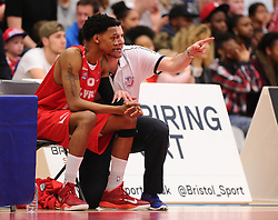 Bristol Flyers head coach, Andreas Kapoulas talks with Bristol Flyers' Bree Perine  - Photo mandatory by-line: Joe Meredith/JMP - Mobile: 07966 386802 - 11/04/2015 - SPORT - Basketball - Bristol - SGS Wise Campus - Bristol Flyers v Glasgow Rocks - British Basketball League