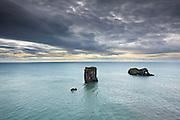 Rocks in the sea by Dyrholaey