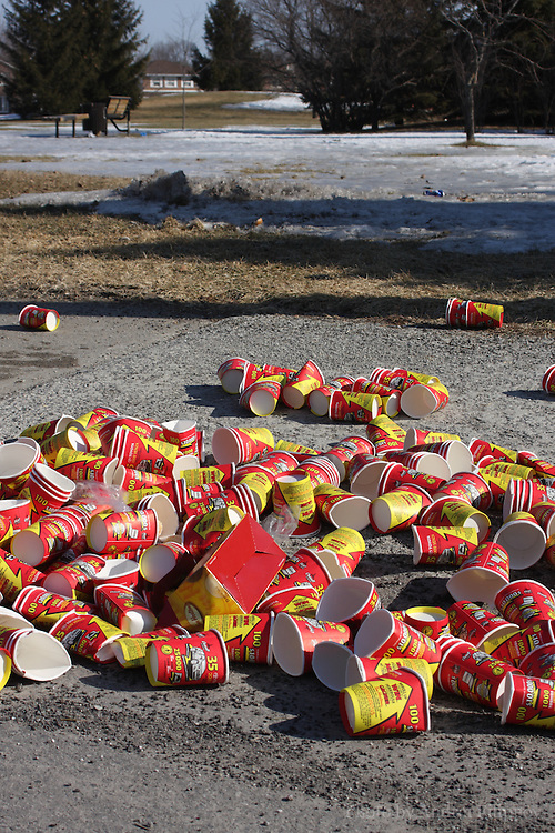 Empty Tim Hortons coffee cups trashed on McLellan St. in Nepean, ON on March 14, 2009. Tim Hortons is a chain of coffee shops founded in Canada.