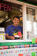 Fernando, owner of Fernando's Alegria food  cart at the Portland Mercado hold fresh veggies that go into the food he makes.