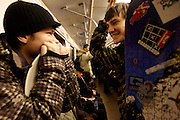 Snowboarders ride a metro train in Moscow. .The Moscow Metro, which spans almost the entire Russian capital, is the world's second most heavily used metro system after the Tokyo's twin subway. Opened in 1935, it is well known for the ornate design of many of its stations, which contain outstanding examples of socialist realist art.