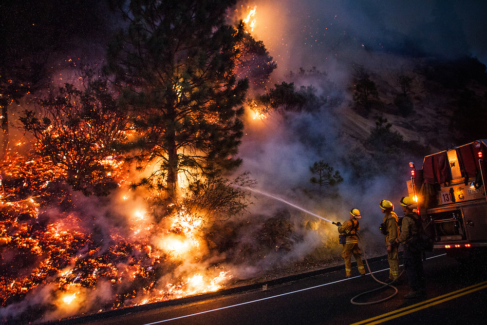 Firefighters work to prevent the Rim Fire from jumping Highway 120 near Buck Meadows, California, August 24, 2013. The Rim Fire burned 257,314 acres and is the third largest wildfire in California history.