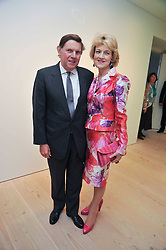 IAN & FIONA SHACKLETON at an exhibition of photographic portraits by Bryan Adams entitled 'Hear The World' at The Saatchi Gallery, King's Road, London on 21st July 2009.