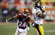 Pittsburgh Steelers wide receiver Antonio Brown (84) catches a late second quarter pass while being covered by Cincinnati Bengals cornerback Adam Jones (24) during the NFL AFC Wild Card playoff football game against the Cincinnati Bengals on Saturday, Jan. 9, 2016 in Cincinnati. The Steelers won the game 18-16. (©Paul Anthony Spinelli)