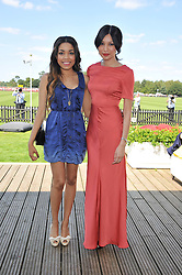 Left to right, DIONNE BROMFIELD and GEMMA CHAN at the Audi International Polo Day held at Guards Polo Club, Smith's Lawn, Windsor on 22nd July 2012.