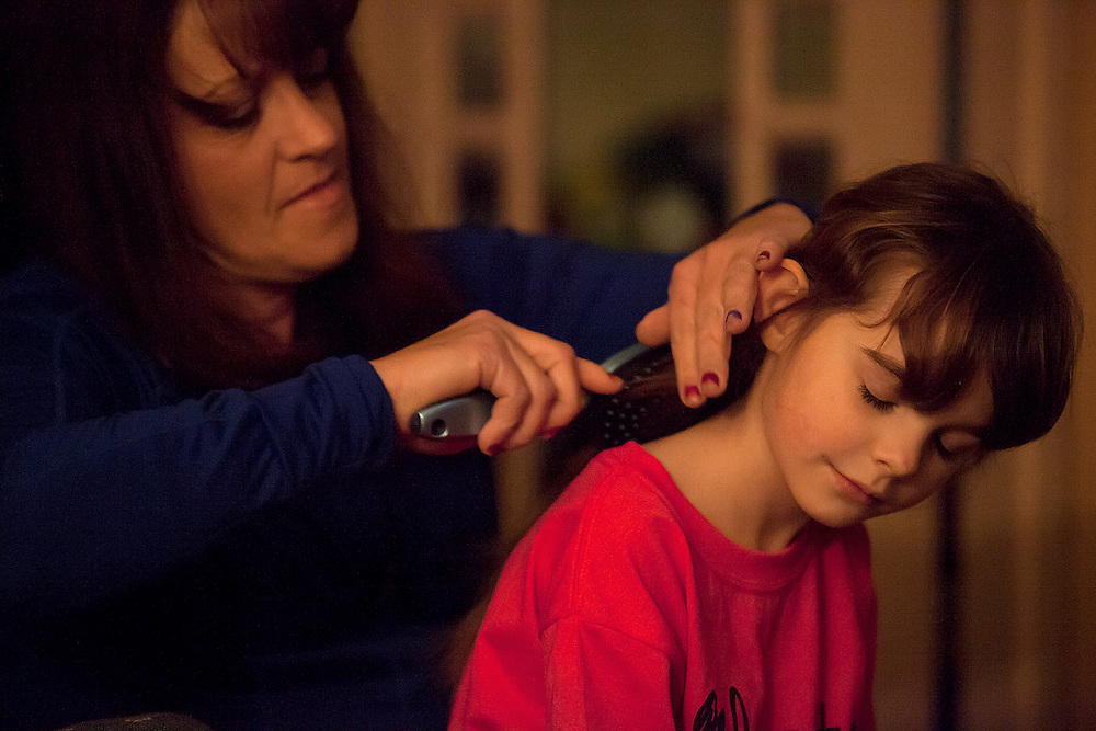 Tara Volz, Kiera's mother, brushed Kiera's hair, before heading to a Southridge boys basketball game in Huntingburg on Jan. 31. Dale allowed Tara to live with them as she looked for more permanent housing. Tara very much wants to be a part of Kiera's life.