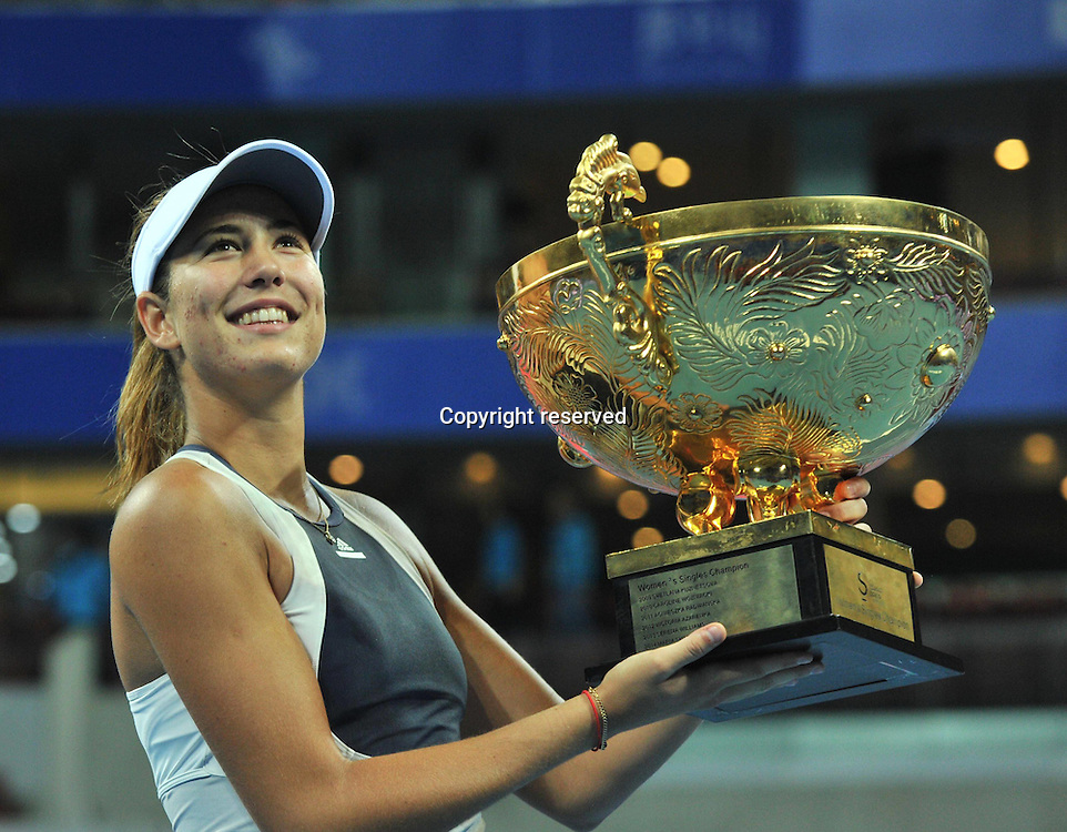11.10.2015. Beijing, China.  Garbine Muguruza of Spain displays her champion trophy during the awarding ceremony for for womens  singles final at 2015 China Open Tennis Tournament in Beijing, China, Oct. 11, 2015. Muguruza claimed the title of the event after beating Timea Bacsinszky of Switzerland 2-0.