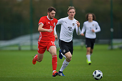 NEWPORT, WALES - Monday, October 14, 2019: Wales' Joe Adams (L) and Austria's Patrick Wimmer during an Under-19's International Friendly match between Wales and Austria at Dragon Park. (Pic by David Rawcliffe/Propaganda)