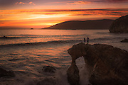 Couple Standing on the Arch During Sunset at Pirates Cove at Avila's Beach