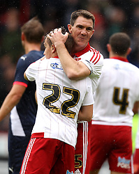 Sheffield United's Chris Morgan hugs Sheffield United's Louis Reed at the end of the formers testimonial - Mandatory by-line: Robbie Stephenson/JMP - 26/07/2015 - SPORT - FOOTBALL - Sheffield,England - Bramall Lane - Sheffield United v Newcastle United - Pre-Season Friendly