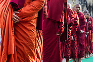Monks in line to receive alms at the Pagoda Festival in Bagan, Myanmar (Burma).
