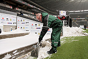 MK Dons fans and staff helping to clear the snow before the EFL Sky Bet League 1 match between Milton Keynes Dons and Bristol Rovers at stadium:mk, Milton Keynes, England on 3 March 2018. Picture by Nigel Cole.