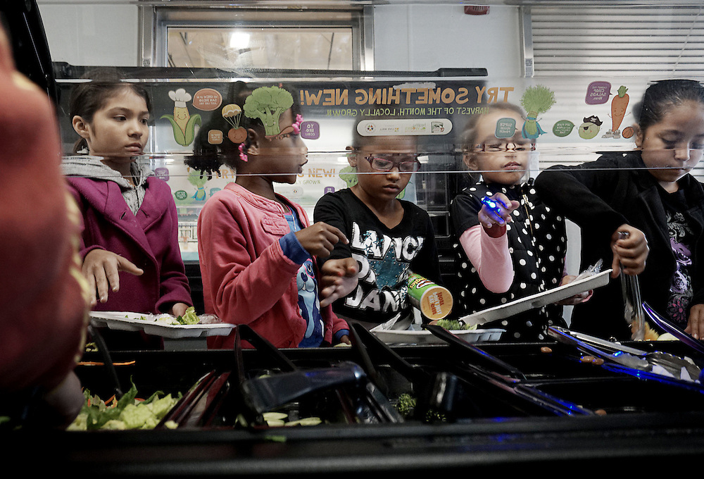 Students make salads during lunch period at the Monarch School in San Diego, CA on Friday, May 15, 2015.  The Monarch School is the largest elementary through High School facility that caters to students that are homeless or are have associations with homelessness.(Photo by Sandy Huffaker for The Atlantic)