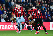 Jack Grealish (10) of Aston Villa goes down after being fouled by Jefferson Lerma (8) of AFC Bournemouth during the Premier League match between Bournemouth and Aston Villa at the Vitality Stadium, Bournemouth, England on 1 February 2020.