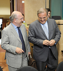 Joaquin Almunia, The EU's commissioner for economic and monetary affairs, left, and Ioannis Papathanasiou, Greece's finance minister, arrive for the Eurogroup meeting at EU headquarters in Brussels, Monday, July 6, 2009. (Photo © Jock Fistick)