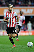 Brentford midfielder Emiliano Marcondes (17) *** during the EFL Sky Bet Championship match between Brentford and Queens Park Rangers at Griffin Park, London, England on 2 March 2019.