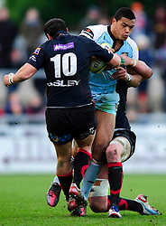 Northampton Inside Centre (#12) Luther Burrell is tackled by Dragons Fly-Half (#10) Dan Evans during the first half of the match - Photo mandatory by-line: Rogan Thomson/JMP - Tel: Mobile: 07966 386802 18/11/2012 - SPORT - RUGBY - Rodney Parade - Newport. Newport Gwent Dragons v Northampton Saints - LV= Cup Round 2
